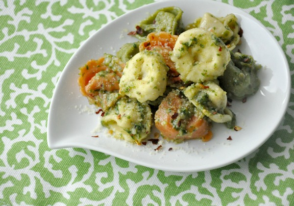 Spoon this garlicky arugula pesto over cheesy tortellini, brush onto crusty french bread, or slather on flaky salmon fillets for pure pesto deliciousness!
