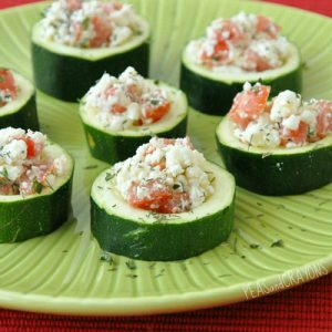 These baked bruschetta zucchini cups make a perfect low carb party appetizer. Light, healthy and delicious, they're packed with tomatoes, herbs, and feta and baked to bubbly perfection!