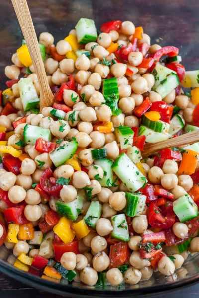 Loaded with fresh veggies and tossed in a light homemade dressing, this tasty vegetarian Greek Chickpea Salad makes healthy eating a breeze! Let's get Mediterranean!