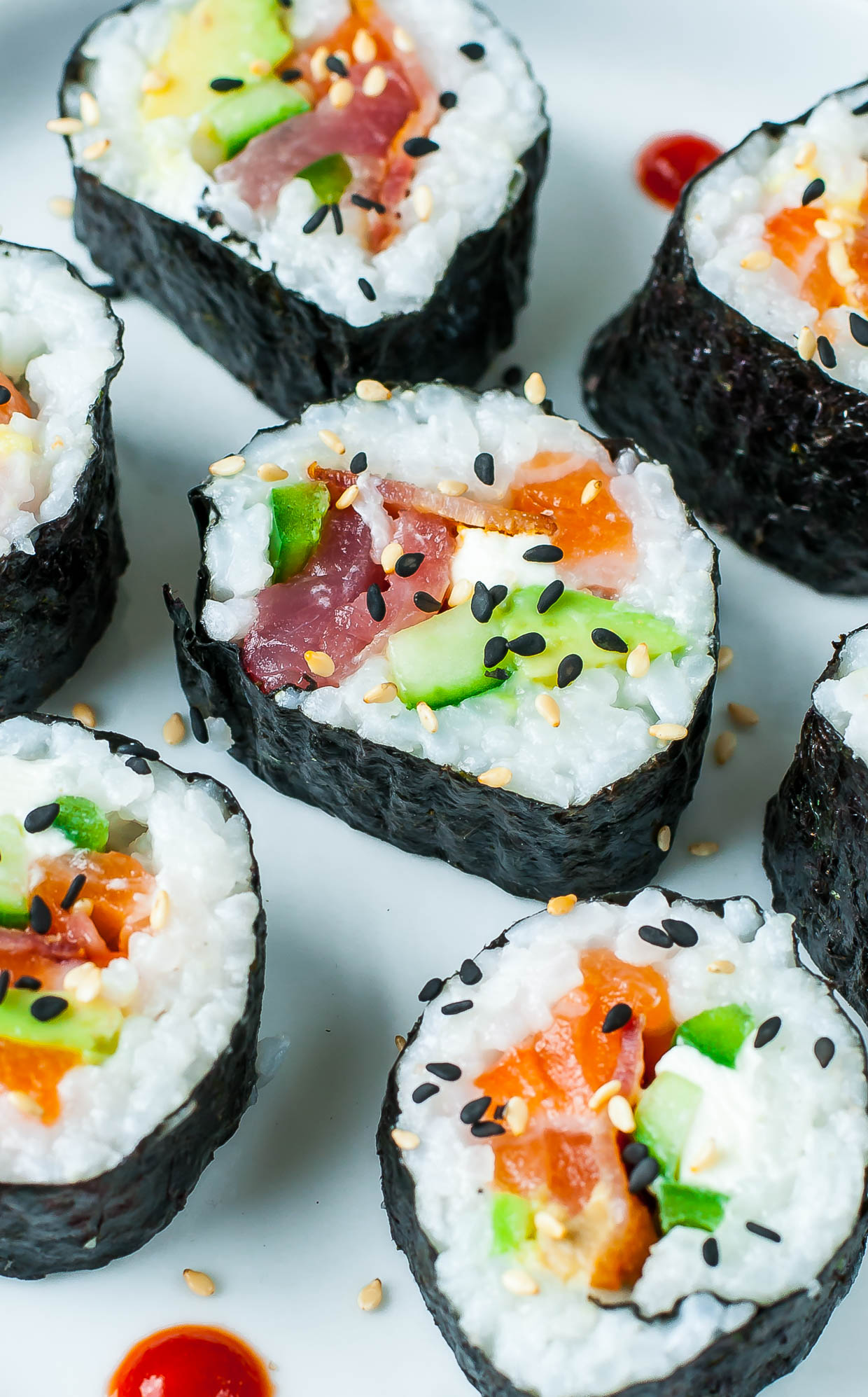 An easy-to-follow homemade sushi tutorial with lots of tips, tricks, and photos to help you roll like a pro along with sushi roll and sauce recipes galore!
