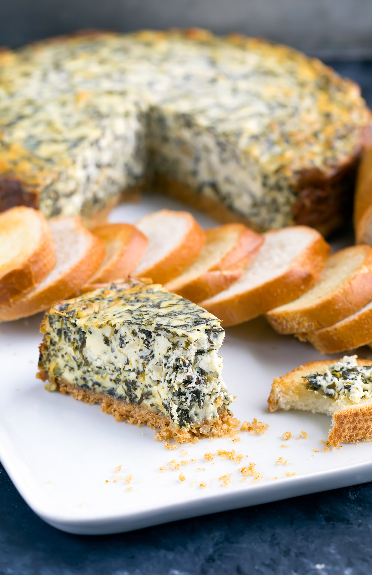 This Savory Spinach Artichoke Cheesecake is a fun and delicious party appetizer!