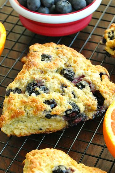 These honey glazed orange blueberry scones are easy to make and bursting with berry flavor! Serve them up for a tasty breakfast or brunch!