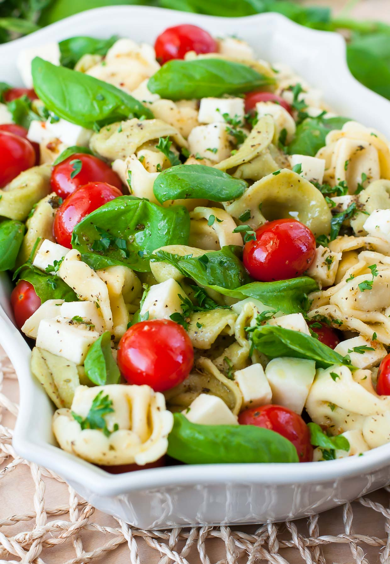 Just when you thought pasta salad couldn't get any better: This caprese tortellini pasta salad is sure to win hearts and tastebuds at your next party or BBQ!