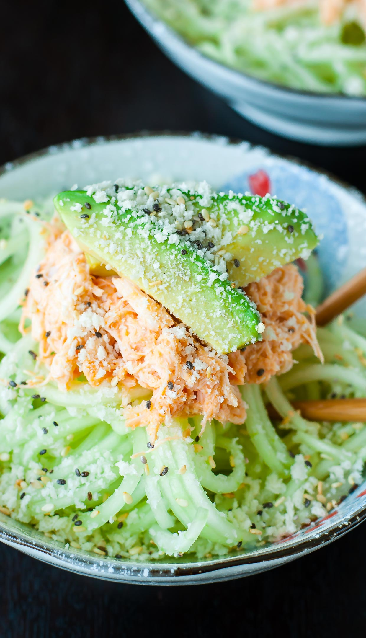 This Spicy Sriracha Crab and Cucumber Salad is refreshing and flavorful!This Japanese-inspired kani salad is my absolute favorite sushi restaurant appetizer. #crab #seafood #pescatarian #healthy #spiralized #spiralizer #cucumber #avocado #sriracha #restaruantcopycat