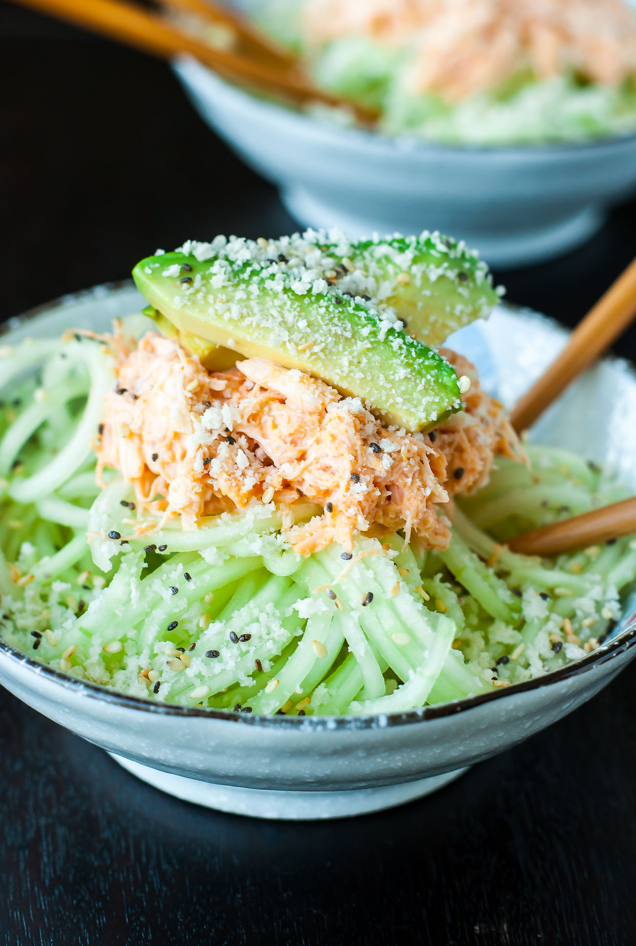 This Spicy Sriracha Crab and Cucumber Salad is refreshing and flavorful! This Japanese-inspired salad is my absolute favorite sushi restaurant appetizer. Make it at home with the recipe for this quick and easy recipe!