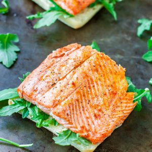 Tips for perfect grilled salmon and a recipe for my favorite Grilled Salmon Sandwiches with pesto, avocado, and arugula: a tasty and healthy Summer sandwich!