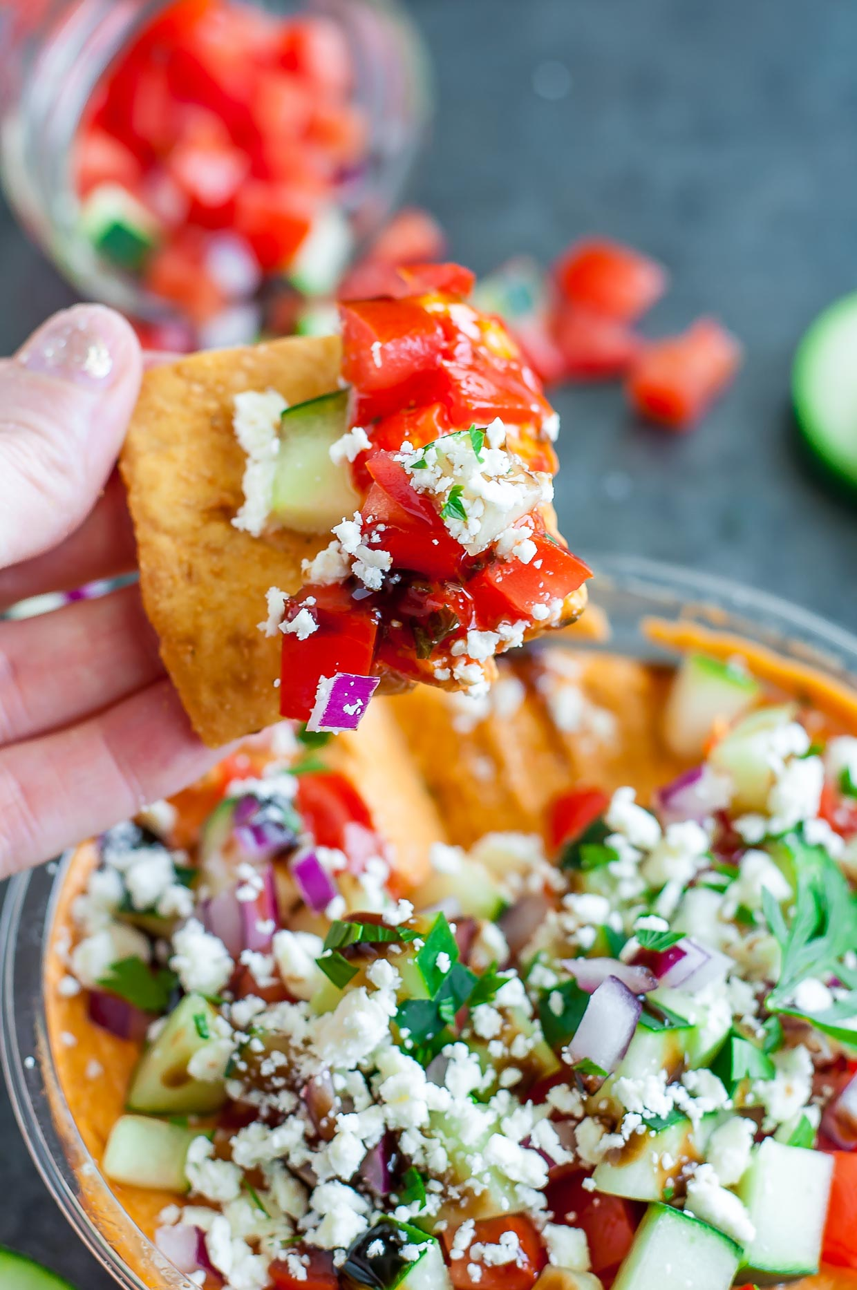 Take store bought bean dip from hummus to YUMMUS with this deliciously speedy shortcut. Tasty hummus is piled high with a mountain of toppings including feta, cucumber, onion, parsley, and drizzled with a sweet and savory balsamic glaze.