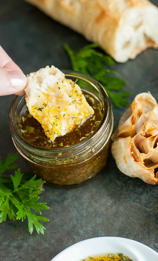 Restaurant-Style Olive Oil and Herb Bread Dip :: Skip the restaurant, grab a fresh baguette, and whip up this wildly addictive roasted garlic olive oil + herb dip... at home!