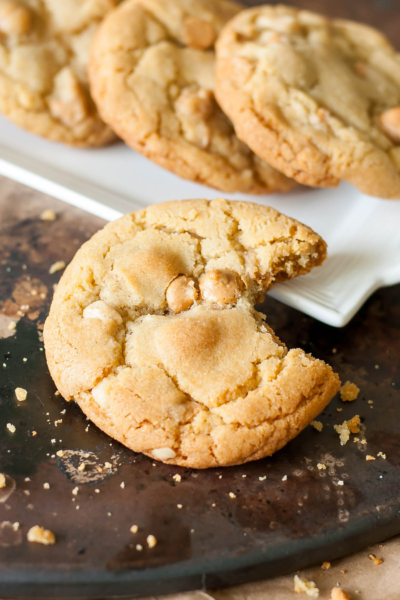 These are hands-down best Peanut Butter Macadamia Nut White Chocolate Cookies of my life! They're crispyon the edges, soft and chewy in the center, and loaded with melty peanut butter chips!