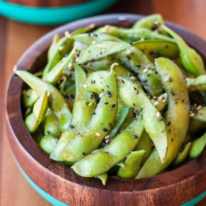 This roasted garlic edamame makes a finger-licking appetizer that's sure to vanish before your eyes! Vegetarian + Gluten-Free