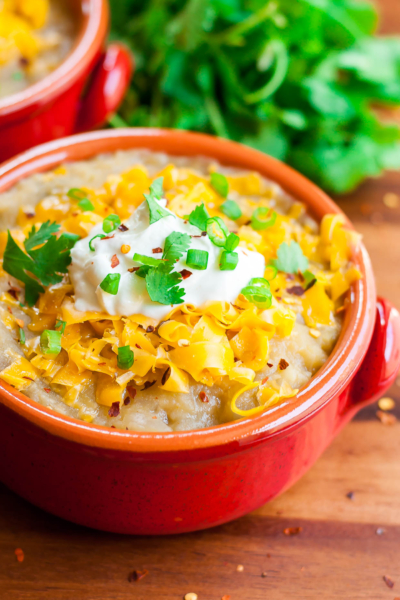 This slow cooker Mexican Baked Potato Soup will warm you up on a cool day with its healthy and delicious twist on classic baked potato soup!