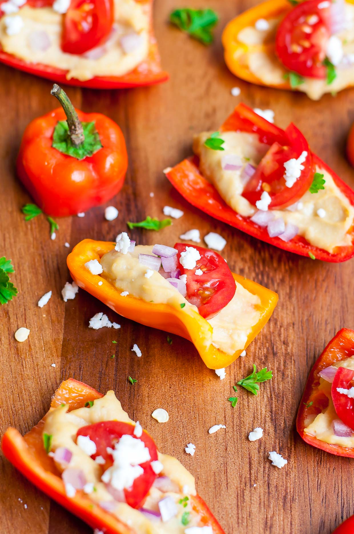Quick, easy, and totally tasty, these healthy hummus stuffed peppers are sure to be a hit at your next party!