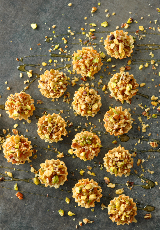 Butternut Baklava Bites: pureed butternut squash spiked with maple and orange, topped with pistachio, pecans, and walnuts and slathered in honey!