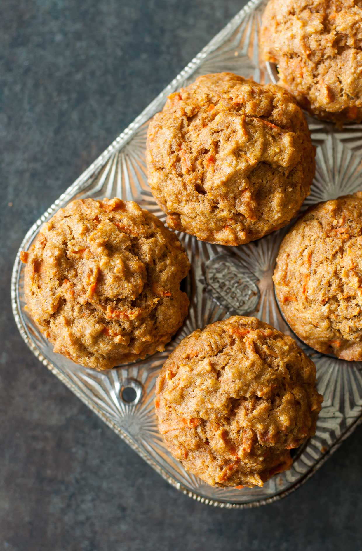 These kid-friendly carrot butternut whole grain muffins are naturally sweetened and totally delicious!