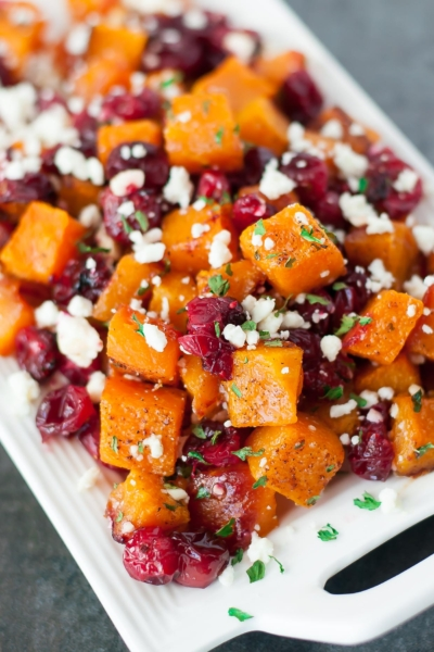 Honey Roasted Butternut Squash with Cranberries and Feta - This sweet and savory side dish is perfect for the holidays and loaded with Fall flavor!