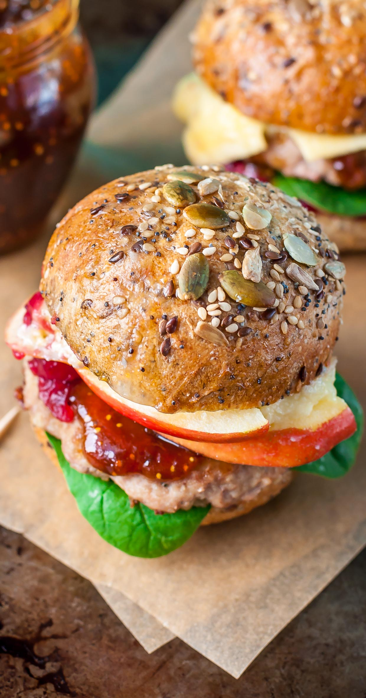Apple, Berry, and Brie Turkey Burger Sliders: these tasty turkey burgers  are topped with apples, cranberry, and brie, then served up slider-style with fig preserves. SO GOOD!
