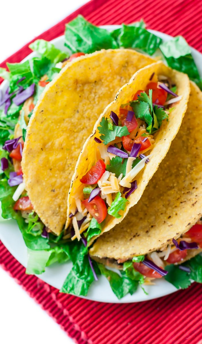 Seasoned black beans, pinto beans, and crunchy taco-roasted chickpeas team up to take your taco game to the next level with these tasty vegetarian triple bean tacos!