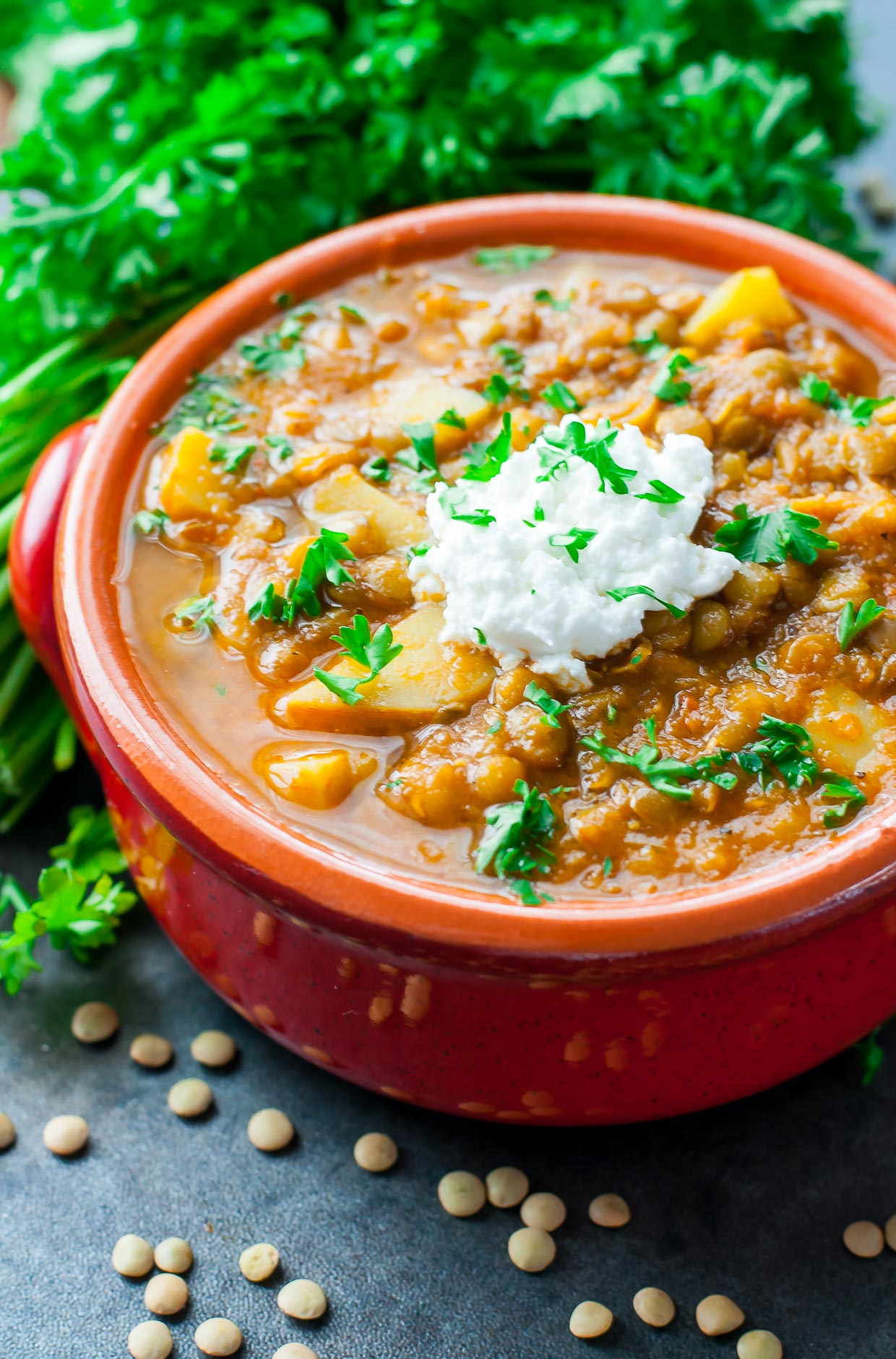 This healthy vegetarian madras lentil soup channels the flavor of my favorite crock-pot lentil dish in a delicious vegan soup!