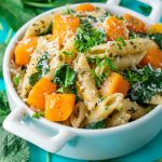 Tender penne pasta tossed with fresh pesto, roasted butternut squash, baby kale, and parmesan cheese. This healthy dish is uber easy and full of flavor!