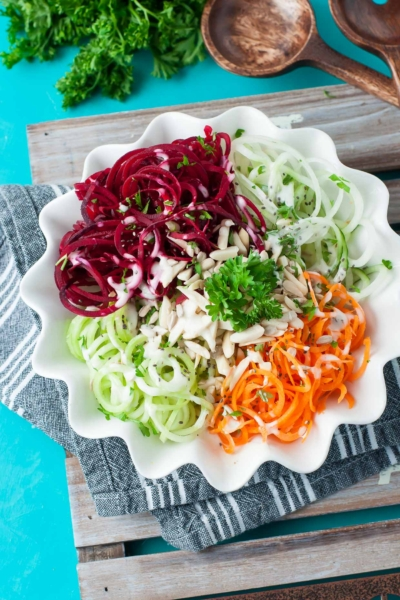 Spiralized Rainbow Veggie Salad - take your veggie noodle game to the next level with beets, broccoli stalk, cucumber, and carrot!
