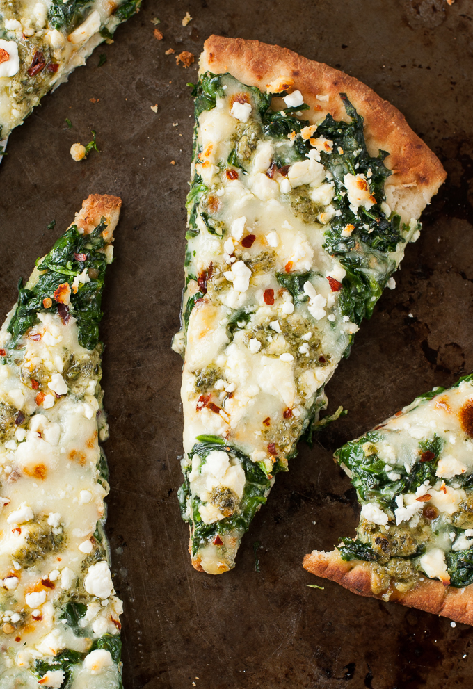 Aiming to eat more veggies? This Three Cheese Pesto Spinach Flatbread Pizza packs an entire box of spinach into one gloriously cheesy single-serving pizza!