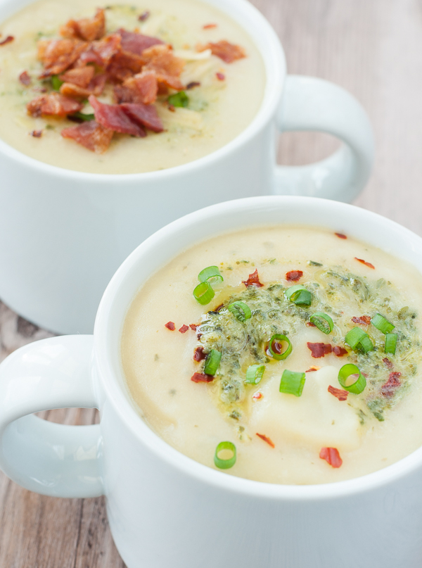 Pesto Potato Soup :: No cream is needed for this lusciously creamy potato soup swirled with pesto for extra oomph! Light and gluten-free, you're free to splurge a little on your choice of toppings!