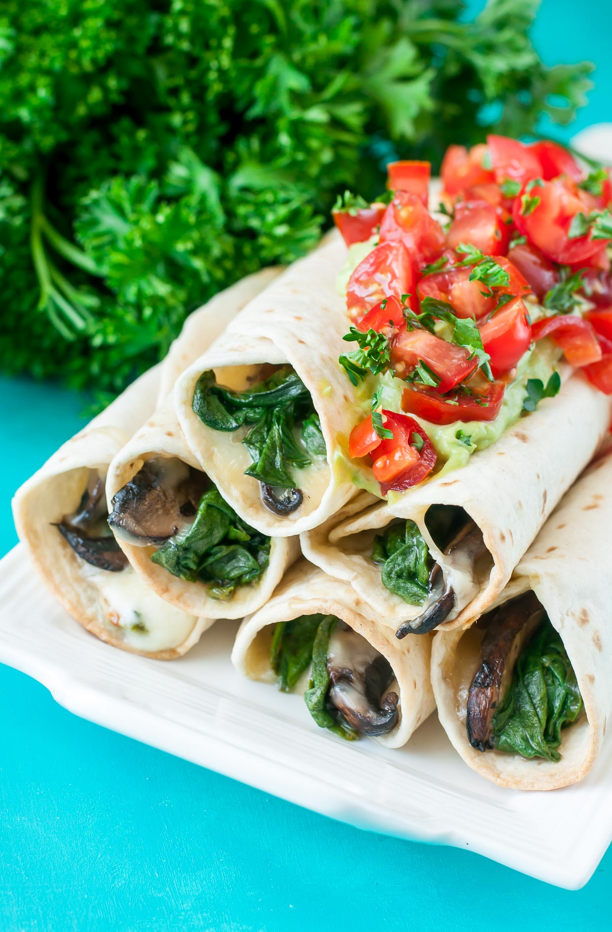 These Cheesy BAKED Spinach and Portobello Flautas are crispy and delicious! Hellooooo veggies!