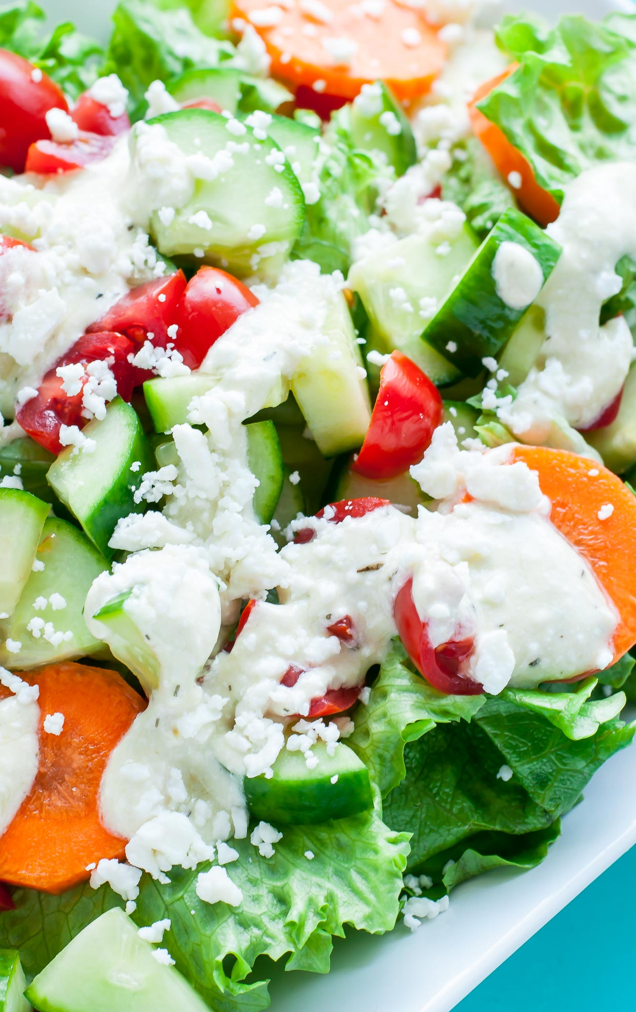 This Creamy Feta Dressing is ready to rock your veggies! Uber easy and ready in just 6 minutes, you'll want to pour this dressing on everything from salads to sandwiches.
