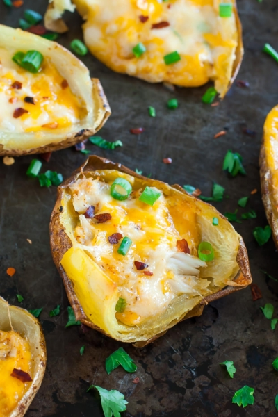A restaurant copycat of myfavorite seafood stuffed potato skins, these cheesyCajun Crab Potato Skins are baked to crispy, melty perfection and are SO easy to make!