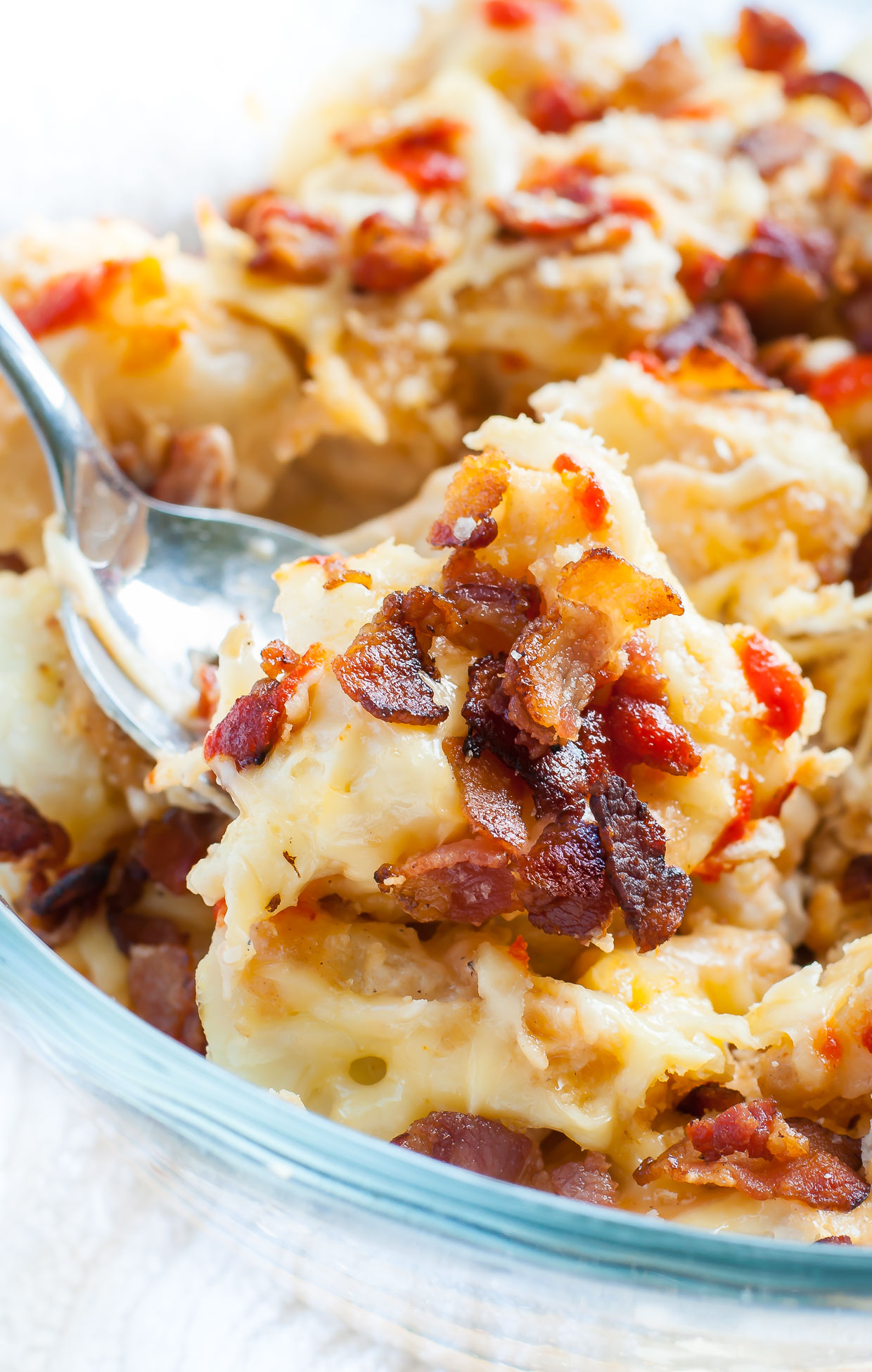This Bacon Sriracha Cauliflower au Gratin is a spotlight-worthy side that's easy, cheesy, and insanely delicious!