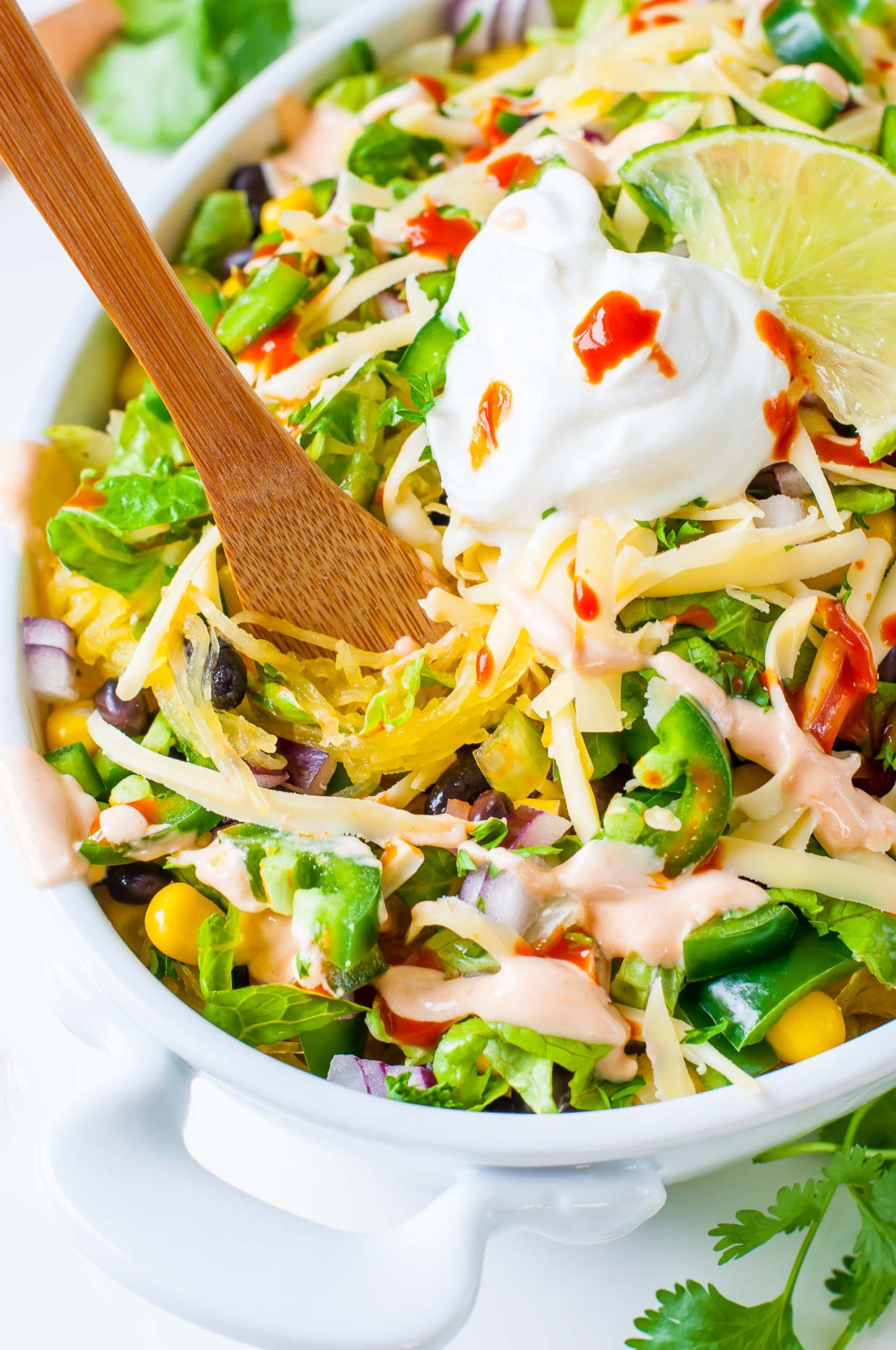 These tasty Spaghetti Squash Burrito Bowls taste just like Chipotle's uber-addictive burrito bowls and are loaded with healthy whole food ingredients!