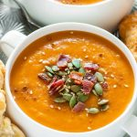 Roast up a tray of delicious winter veggies and sit back as your slow cooker turns them into the most silky carrot butternut soup!