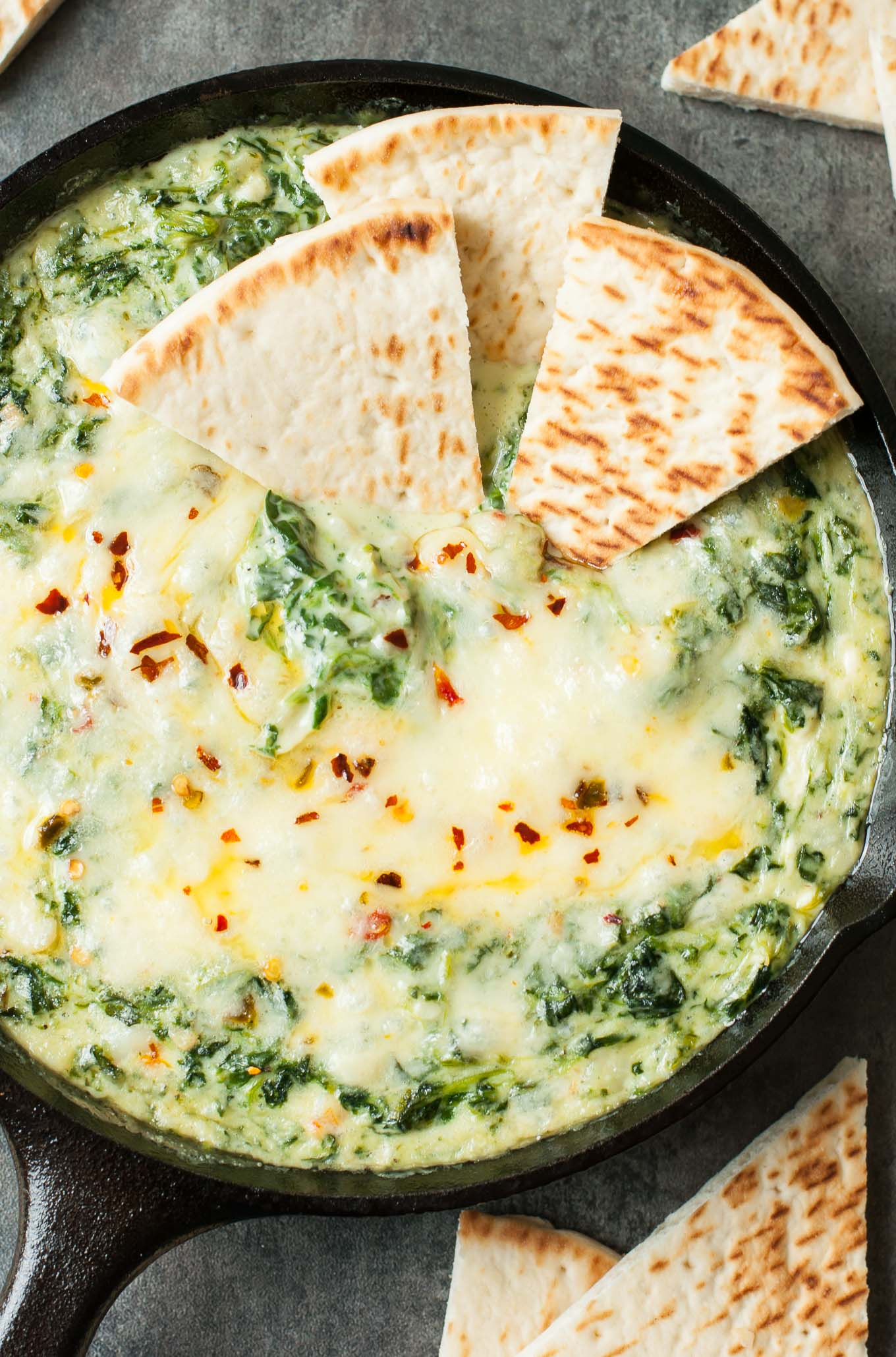 Serve this Cheesy Baked Shrimp and Spinach Dip at your next party and it's sure to be the first dish devoured! My friends and family BEG for me to make it!