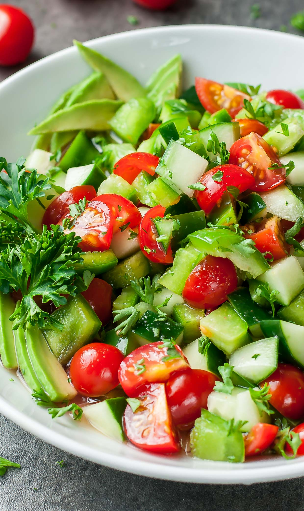 This healthy Tomato Cucumber Avocado Salad is light, fresh, and full of flavor! Vegan + Paleo + Whole30 + Low-Carb + Gluten-Free