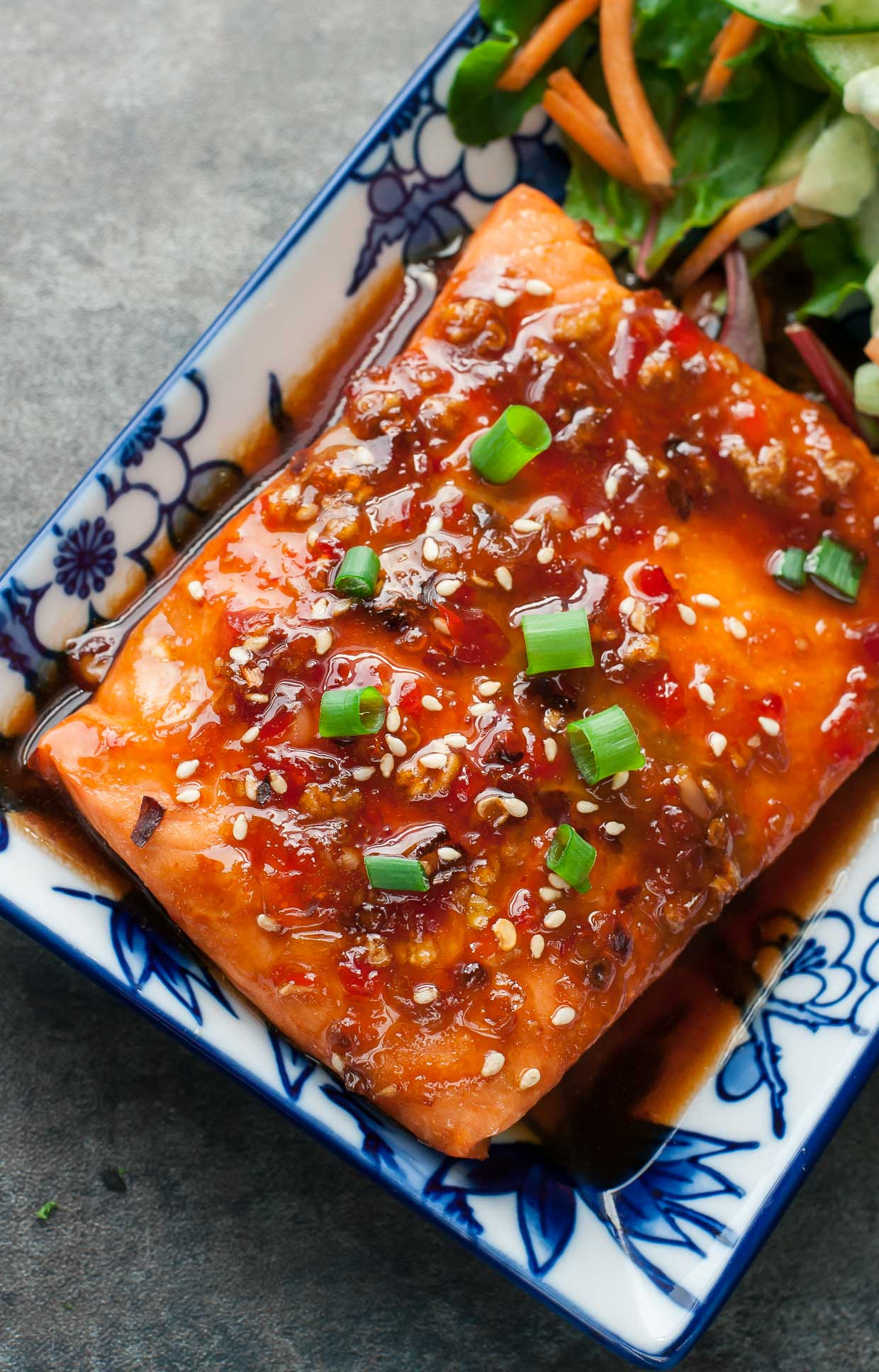 Looking for a new way to jazz up salmon and make it taste GREAT!? This tasty glazed Sweet Chili Sriracha Salmon is quick, easy, and makes an impressive weeknight dinner that's full of flavor!