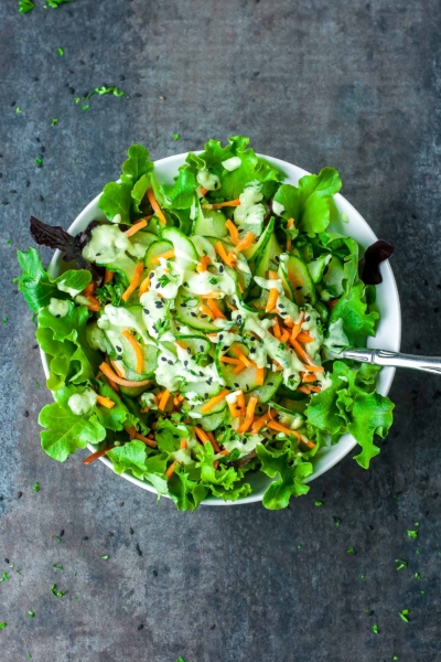 This wasabi cucumber avocado dressing is super creamy and full of flavor! Pair it with a spiralized cucumber and carrot salad for a delicious vegan dish that'll shake up your salad game!