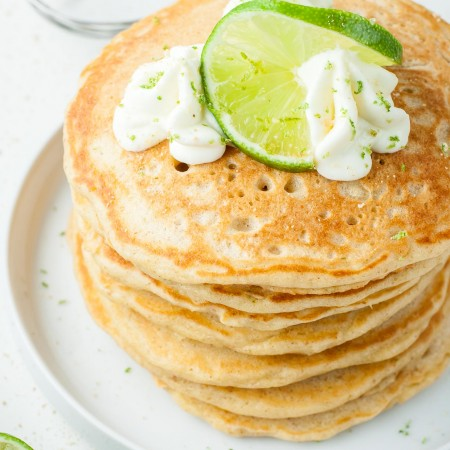 Ultra fluffy and bursting with flavor, these tasty Key Lime Pie Pancakes are guaranteed to turn breakfast into the BEST meal of the day!