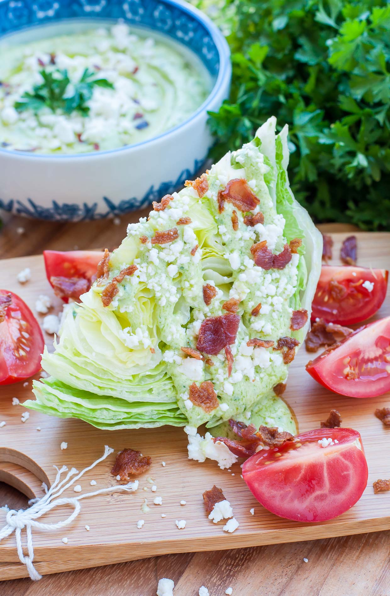 A tasty twist on the classic iceberg wedge, this Green Goddess Wedge Salad is topped with an ultra creamy dressing made with avocado, greek yogurt, feta, and herbs. Delicious and Mayo-Free!