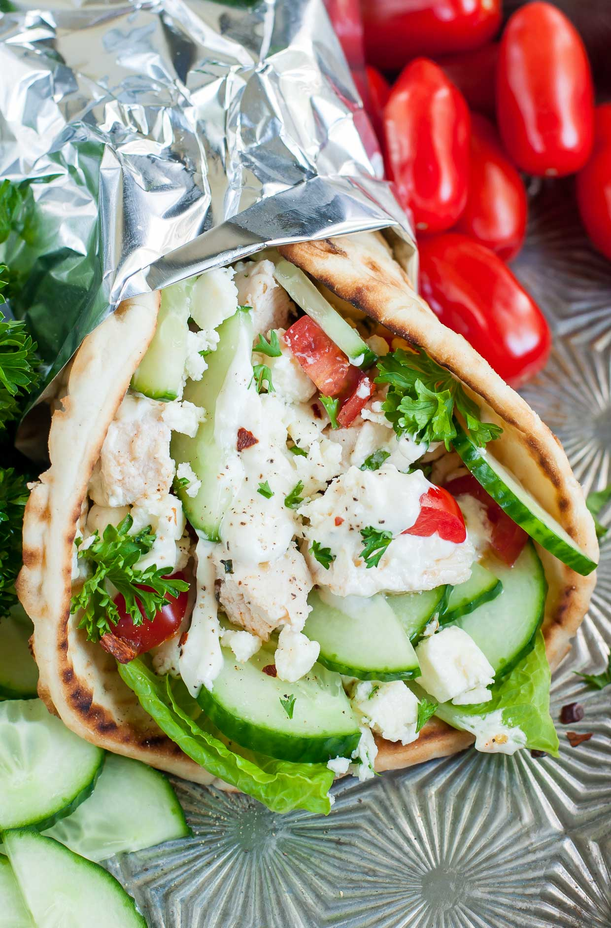 These quick and easy chicken gyros with Greek feta sauce are so super versatile and great for a speedy lunch or easy weeknight dinner. You can use grilled, baked, leftover, or even rotisserie chicken or go veggie and add sautéed onions and peppers to the mix!