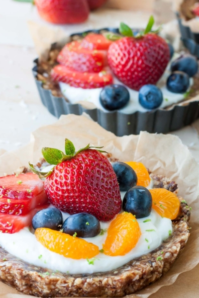 Entertain effortlessly with these healthy no-bake coconut lime fruit and yogurt tarts. They're gluten-free and naturally sweet!