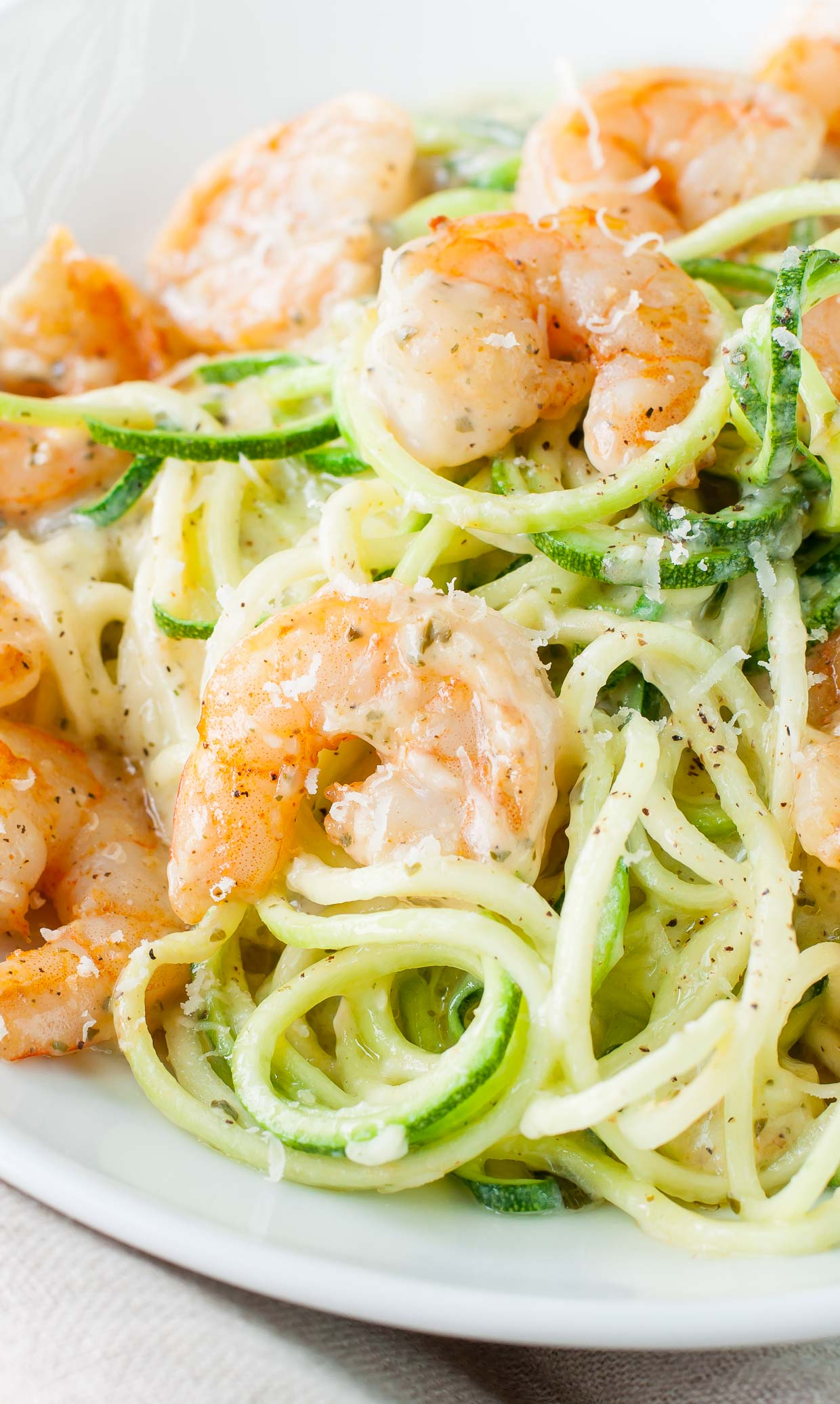Ready for some easy peasy comfort food with a light and creamy twist? Shrimp and Zucchini Noodles in a Parmesan Pesto Cream Sauce... pencil it in for lunch or dinner this week and prepare to swoon!