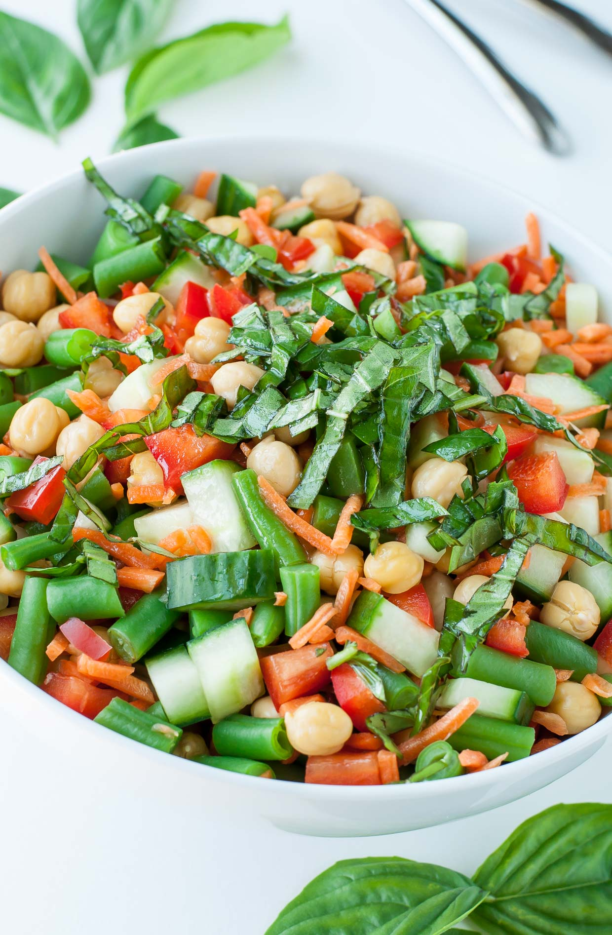 We're nuts about this Chickpea Chopped Salad with Basil Vinaigrette Dressing! Quick, easy, and oh so delicious, this veggie-packed salad is ready to rock your Summer. V + GF