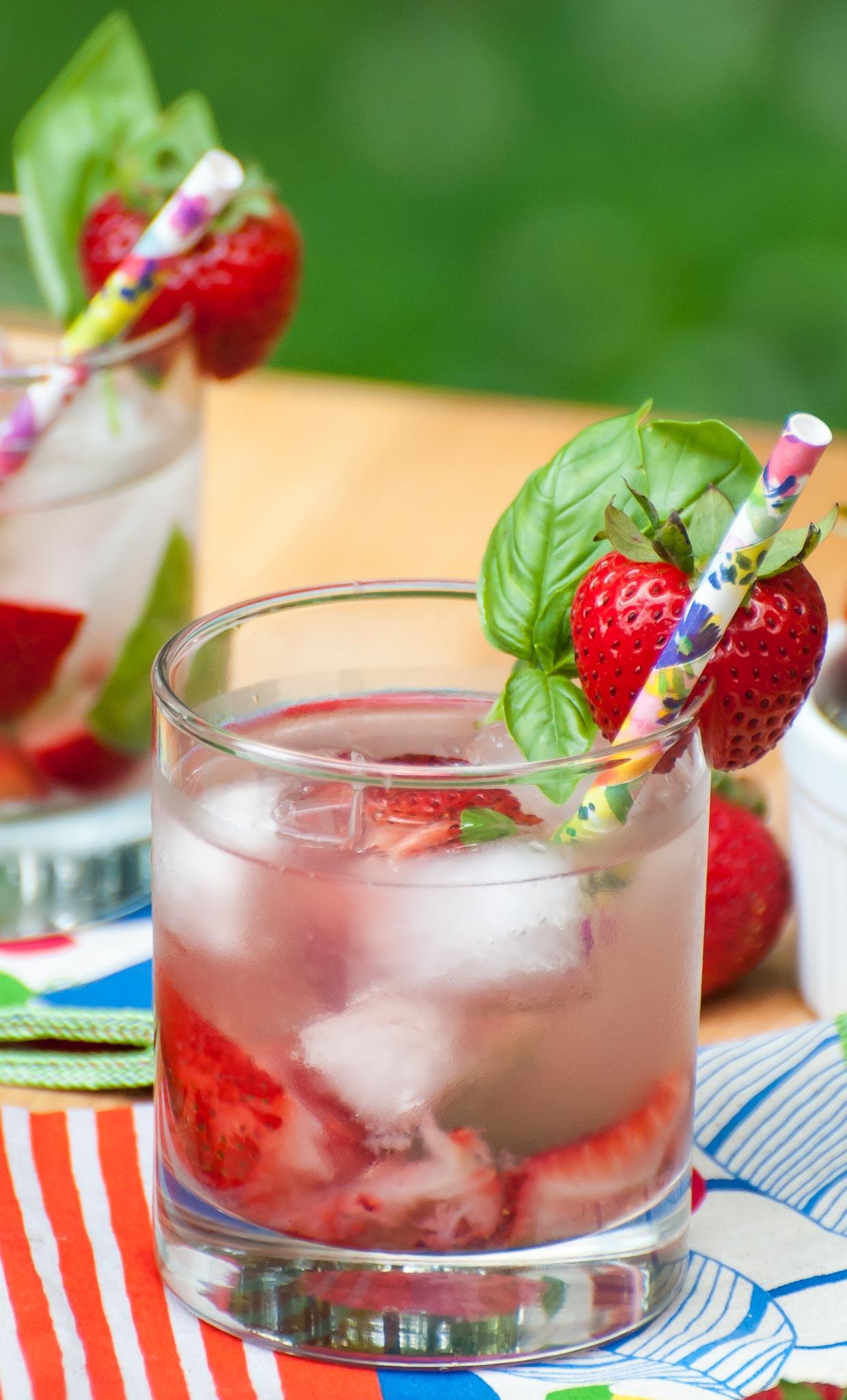 This Strawberry Basil Caipirinha cocktail tastes like Summer in a glass!
