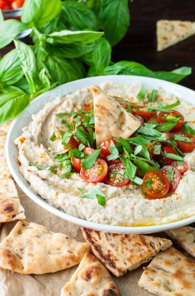 Tomato Basil White Bean Dip :: This easy breezy appetizer doubles as a healthy snack! It comes together in just minutes and can be made/prepped in advance too. Pop leftovers in the fridge for an extra snack sesh or two throughout the week.