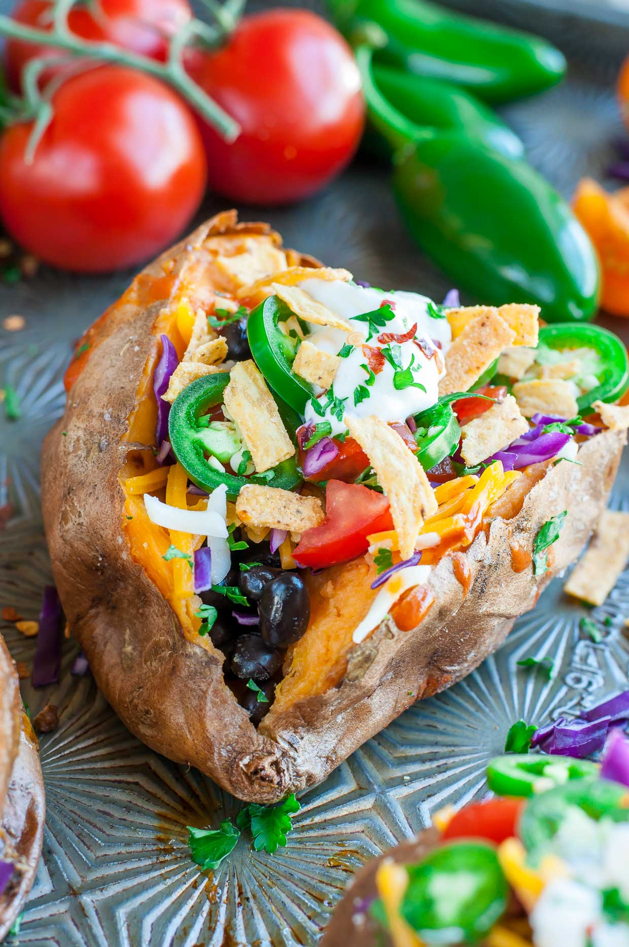 Aiming to eat more veggies? Load up on the good stuff by topping baked sweet potatoes with all your favorite taco ingredients. Bonus points for sneaking veggies into the taco filling too! These bad boys are naturally gluten free and easily made vegan, vegetarian, or paleo -- enjoy! :: Taco Stuffed Sweet Potatoes