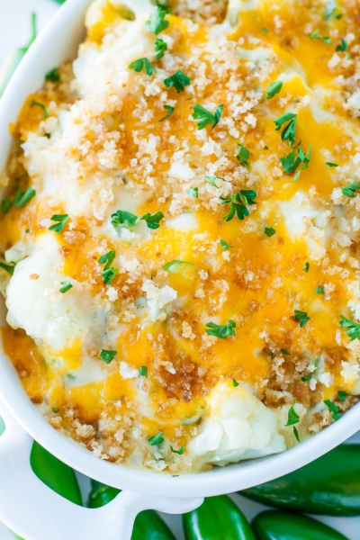 Totally unconventional and wildly delicious, this Creamy Cauliflower Jalapeño Popper Casserole is an easy cheesy veggie gratin with a kick!