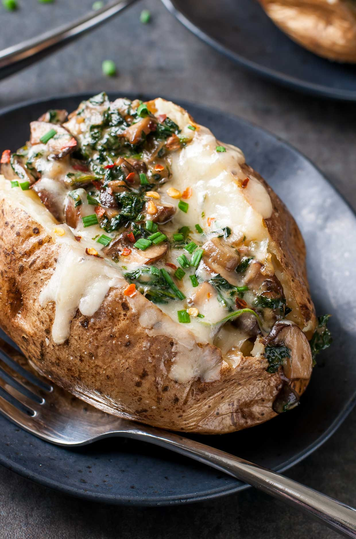 Cheesy Vegetarian Loaded Baked Potatoes with Spinach and Mushrooms