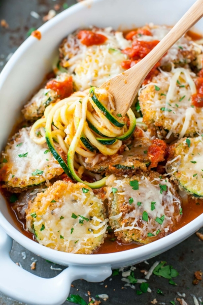 We're in love! Even my husband approves of this easy cheesy Zucchini Parmesan...