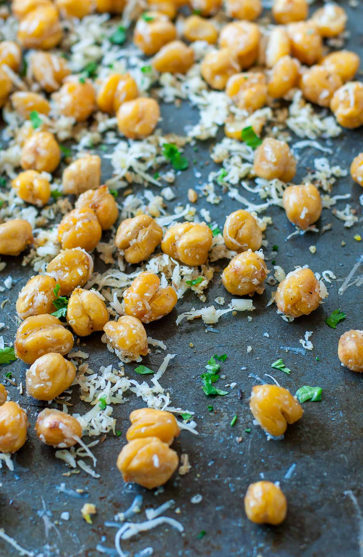 These crispy roasted parmesan chickpeas are a healthy snack loaded with protein, fiber, and a whole lot of deliciousness!