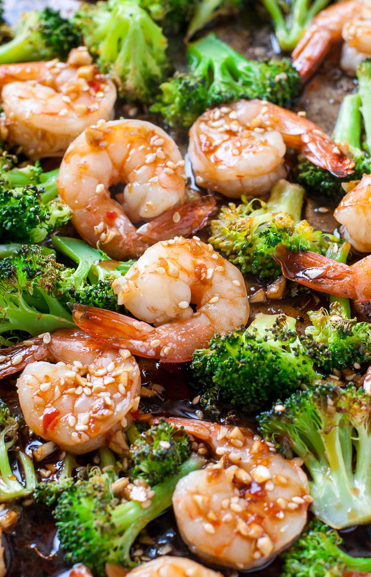 Flavorful roasted broccoli and tender, juicy shrimp join forces in this super easy Sheet Pan Roasted Honey Garlic Shrimp and Broccoli. This one pan wonder makes a great fuss-free weeknight dinner!